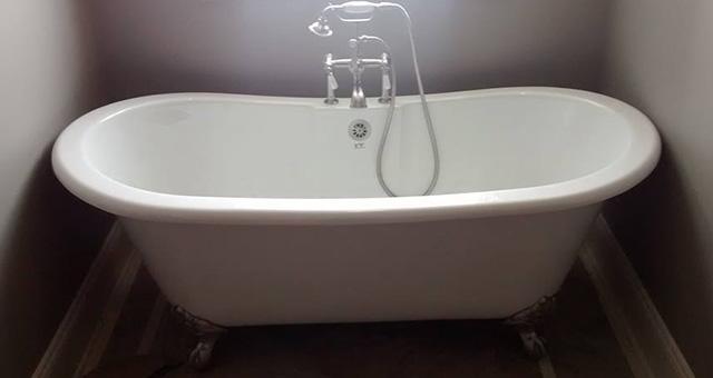 Triton Services project installing a master bathtub for soaking.